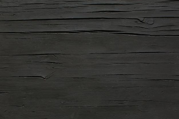 Schwarzer tisch aus mattem holz Kostenlose Fotos