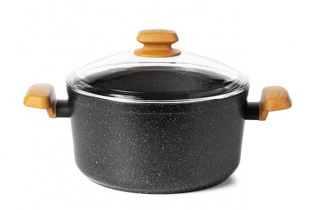 Schwarzes neues kochgeschirr-utensil lokalisiert auf weiß Premium Fotos