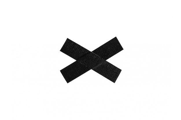 Schwarzes stoff-oberbeleuchterbandkreuz lokalisiert auf weißem hintergrund. Premium Fotos