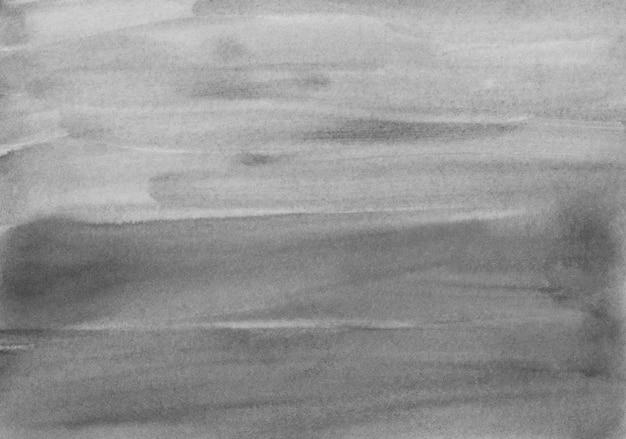 Schwarzweiss-hintergrundbeschaffenheit des aquarells. pinselstriche auf papier. Premium Fotos