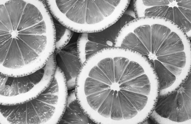 Schwarzweiss-nahaufnahme von zitronenscheiben Kostenlose Fotos