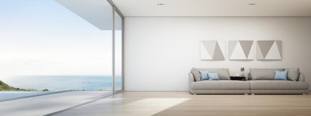 Seeansichtwohnzimmer des luxussommerstrandhauses mit swimmingpool und hölzerner terrasse. Premium Fotos