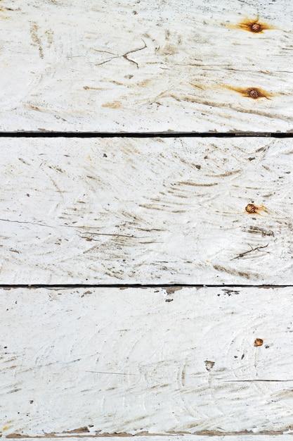 Seedampf verkratzte weiße gemalte hölzerne beschaffenheit. Premium Fotos