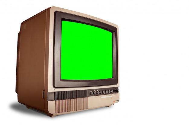 Seitenansicht des alten retro- hauptfernsehempfängers mit leerem grünem schirm mit beschneidungspfad Premium Fotos