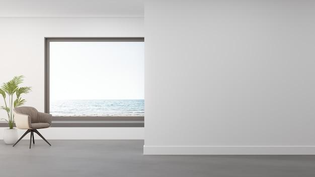 Sessel auf betonboden des großen wohnzimmers im modernen haus oder im luxushotel. Premium Fotos