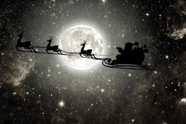 Silhouette eines fliegenden goth santa claus vor dem hintergrund des nachthimmels Premium Fotos