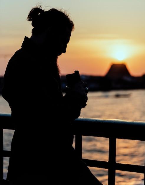 Silhouette eines fotografen Kostenlose Fotos