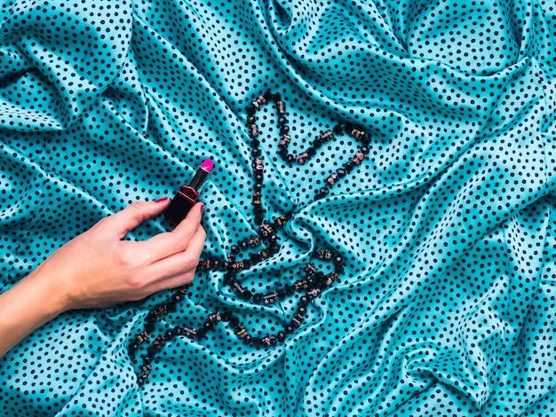 Silk grüner tupfenkleid-beschaffenheitshintergrund Premium Fotos