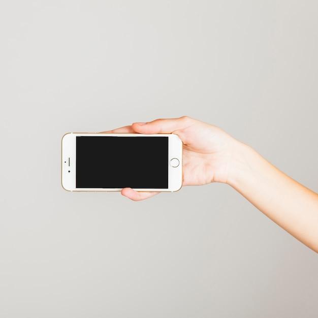 Smarphone und hand Premium Fotos