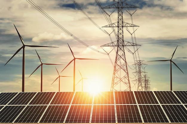 Sonnenkollektor mit turbine und turmhöhenspannungssonnenuntergang Premium Fotos