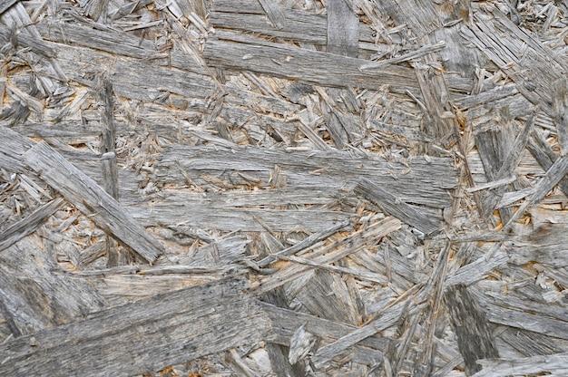 Sperrholz graue farbe. hintergrundtextur der gealterten sperrholzplatte mit fragmenten des komprimierten sägemehls Premium Fotos