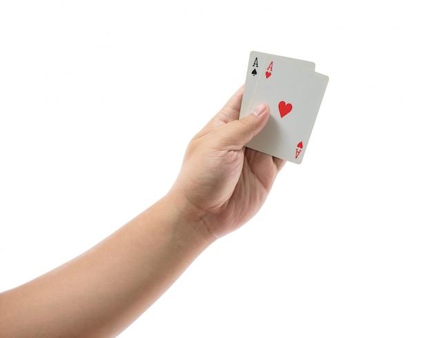 Spielkarten in der hand getrennt auf weiß Premium Fotos