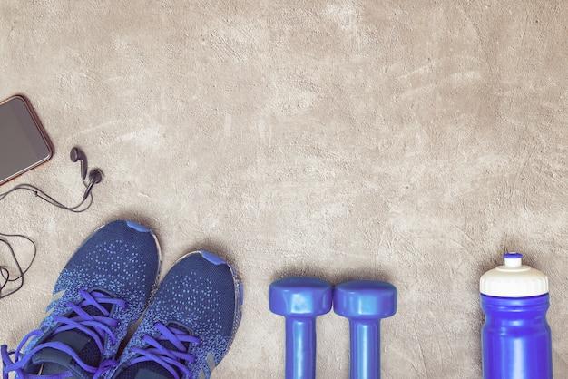 Sport konzept hintergrund. ausrüstung für das training. Premium Fotos