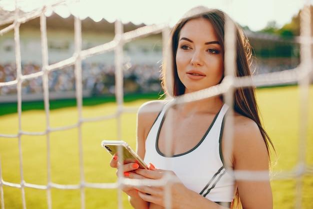 Sportmädchentraining am stadion Kostenlose Fotos