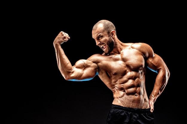 Starker kahlköpfiger bodybuilder mit sixpack. Premium Fotos