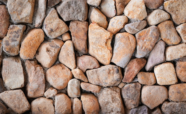 Steinbeschaffenheit schönes steinwandhintergrundbraunes mustersteinwand-naturstein backg Premium Fotos