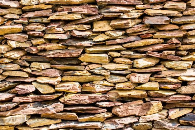 Steinmauer für hintergrund, plattensteinmauerbeschaffenheit. Premium Fotos