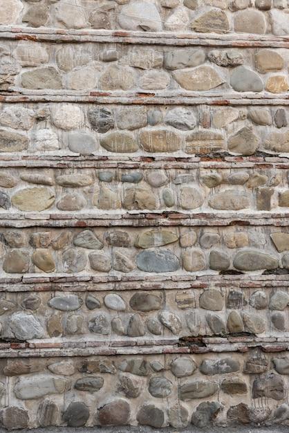Steinmauer und betonhintergrund Premium Fotos