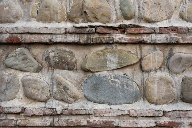 Steinwand. hintergrund. vertikale und horizontale steinschichten Premium Fotos