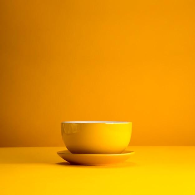 Stillleben der gelben tasse Kostenlose Fotos