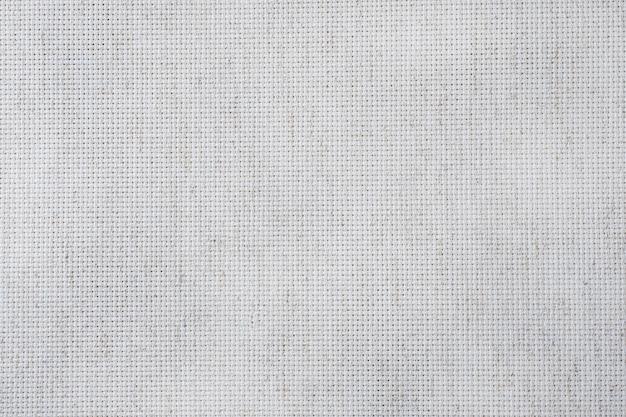 Stoff leinwand für kreuzstich handwerk. textur aus baumwollstoff. Premium Fotos