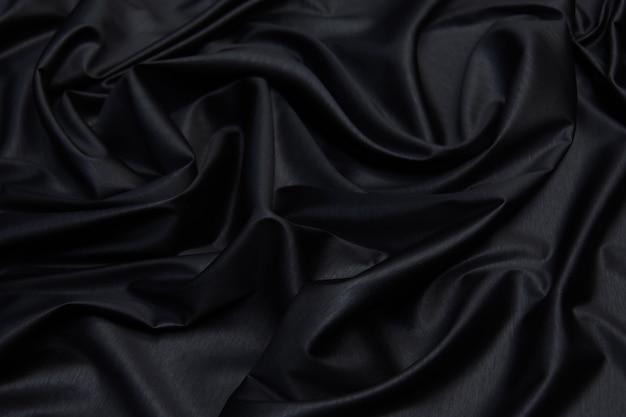 Stoff textur, nahaufnahme textur von schwarzem stoff oder jersey-muster für webdesign und tapeten hintergrund verwenden Premium Fotos