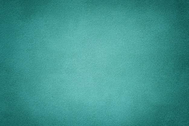 Stoffhintergrund aus türkis mattem wildleder. samt textur. Premium Fotos