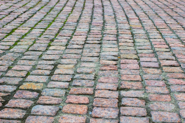 Straßenabdeckung aus granit. bauraum. nahansicht Premium Fotos