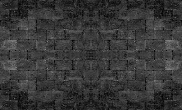 Strukturierte wand des alten schwarzen quadratischen ziegelsteines für dunkle tonweinlese innenarchitektur. Premium Fotos