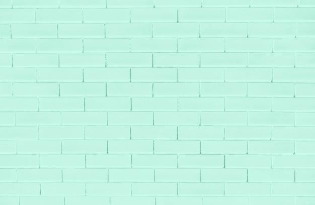 Strukturierter hintergrund der grünen backsteinmauer Kostenlose Fotos