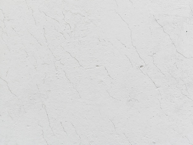 Strukturierter hintergrund der weißen gebrochenen wand Kostenlose Fotos