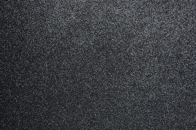 Strukturierter hintergrund des holperigen schwarzen funkelns, nahaufnahme Premium Fotos