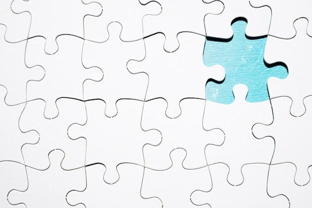 Stück, das vom weißen puzzlen fehlt Kostenlose Fotos