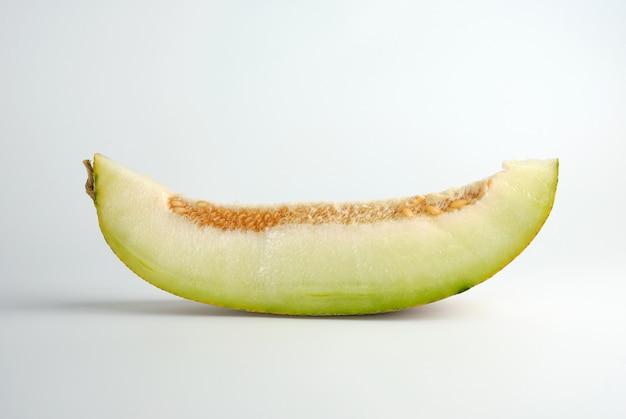 Stück reife melone mit samen Premium Fotos