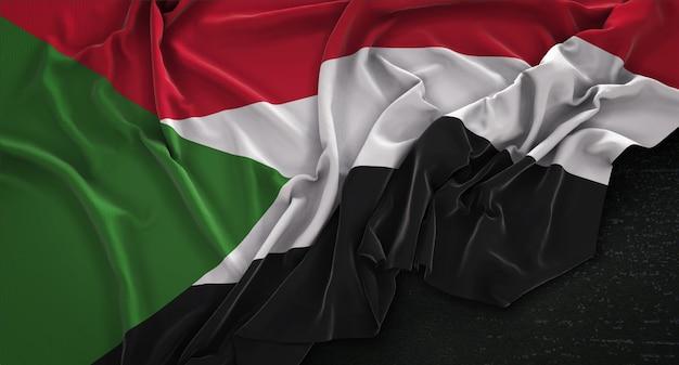 Sudan-flagge auf dunklen hintergrund gestrickt 3d render Kostenlose Fotos