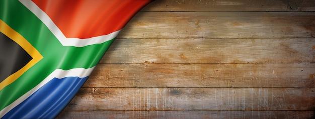 Südafrika flagge auf vintage holzwand Premium Fotos