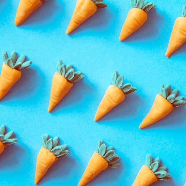 Süße karotten als buntes muster Kostenlose Fotos