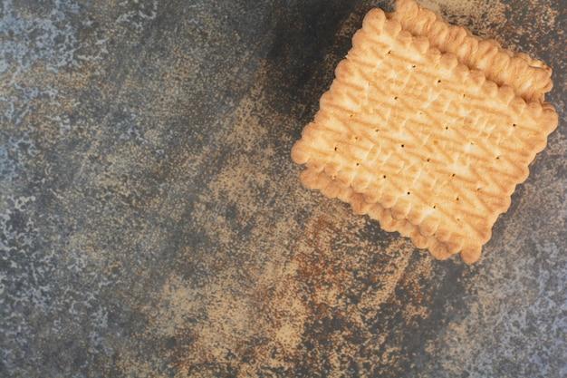 Süße leckere cracker auf marmorhintergrund. hochwertiges foto Kostenlose Fotos