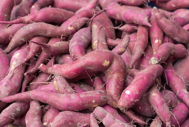 Süßkartoffel hintergrund Premium Fotos