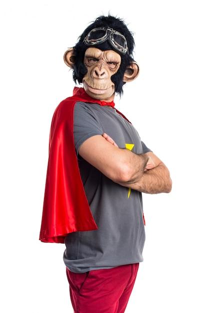 Superheld-affen mann mit gekreuzten armen Kostenlose Fotos