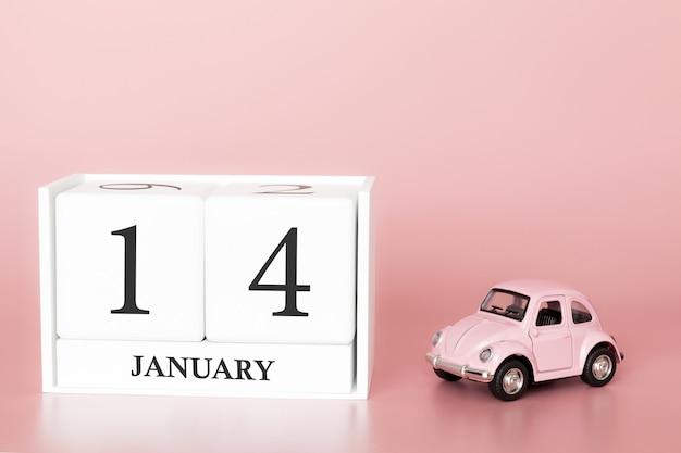 Tag 14 des januar-monats, kalender auf einem rosa hintergrund mit retro- auto. Premium Fotos