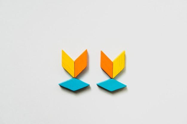 Tangram puzzlespielbaum-formgebrauch für bildung und kreatives konzept Premium Fotos