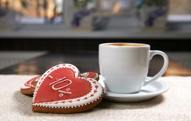 Tasse kaffee mit keksen Kostenlose Fotos