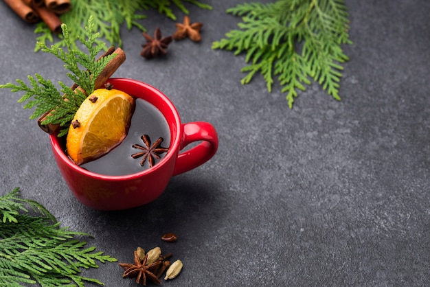 Tasse tee mit zitrone und früchten mit kopierraum Kostenlose Fotos