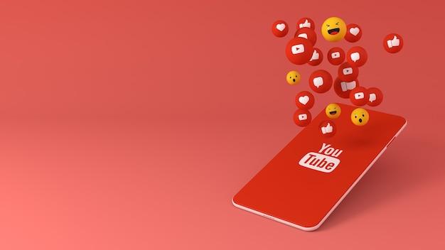Telefon mit youtube popping up icons Premium Fotos