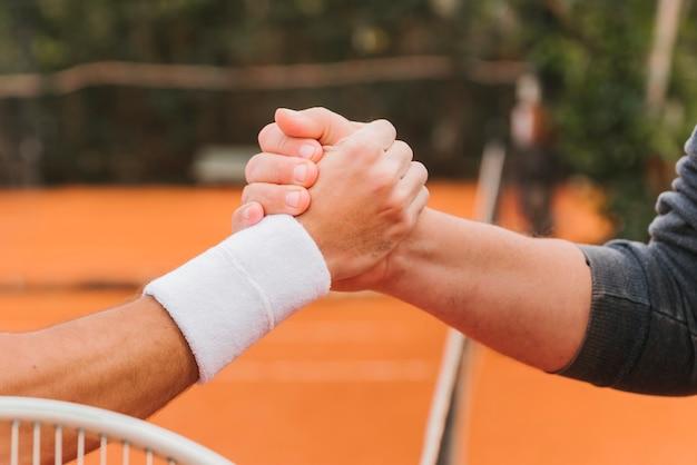 Tennisspieler, die hände halten Kostenlose Fotos