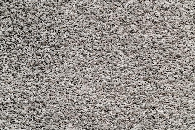 Teppichbeschaffenheiten für hintergrund Premium Fotos