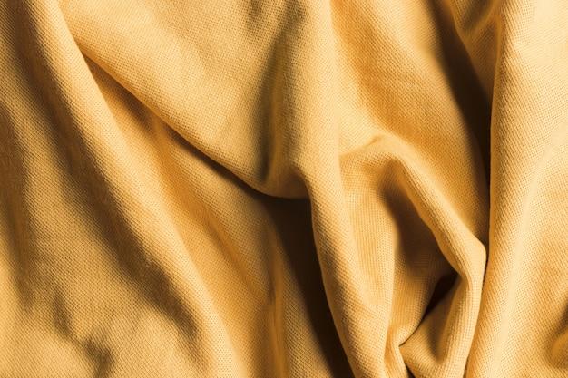 Textur aus sandbraunem, zerknittertem stoff Kostenlose Fotos