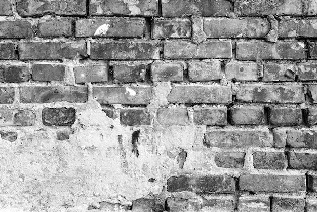 Textur, backstein, wand hintergrund. ziegelsteinbeschaffenheit mit kratzern und sprüngen Premium Fotos