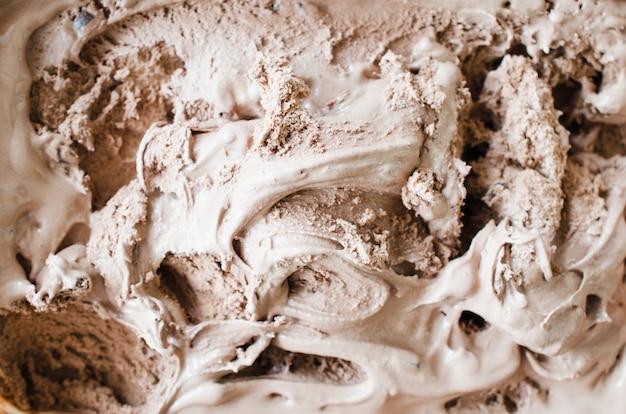 Textur der schmelzenden schokoladeneis. brauner hintergrund Premium Fotos